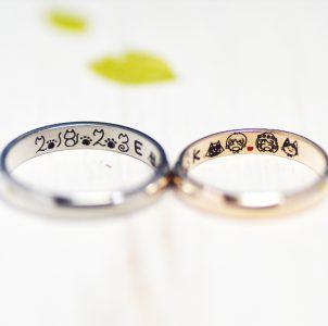 10、2人の似顔絵と記念日を描いた結婚指輪